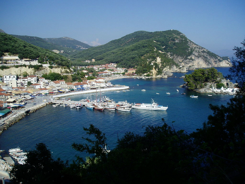 Beautiful Parga in Western Greece with small island across the water from the town. Photo courtesy of Wikipedia Commons. Author: Sakis Kostaris