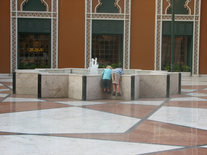Kids-inspect-the-marriott-hotel-fountain-cairo