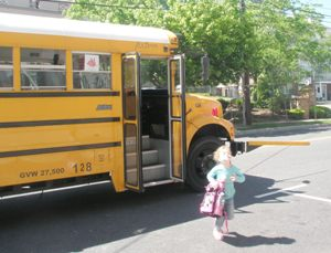 child-getting-off-yellow-school-bus