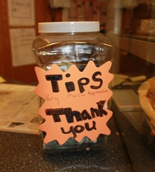 Sometimes, a tip jar is placed at the front counter in a cafe or counter service area, and tips distributed to staff afterwards.