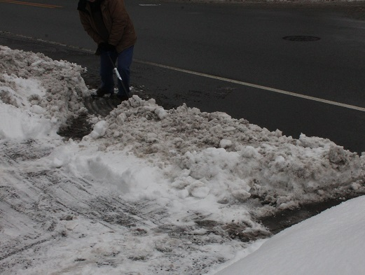 Shoveling-heavy-snow-left-by-snow-plows