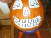 Fit the design elements onto the pumpkin to suit the pumpkin shape.