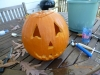 The pumpkin carving of the Jack-O-Lantern design is completed