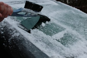 Ice-scraper-removing-iced-up-snow-from back-windscreen