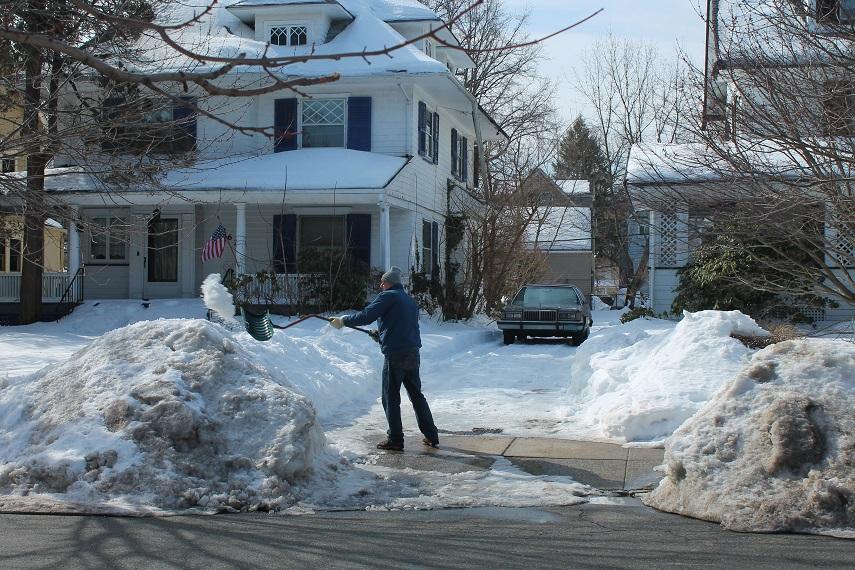 man-shoveling-snow-out-of-driveway-winter-nj