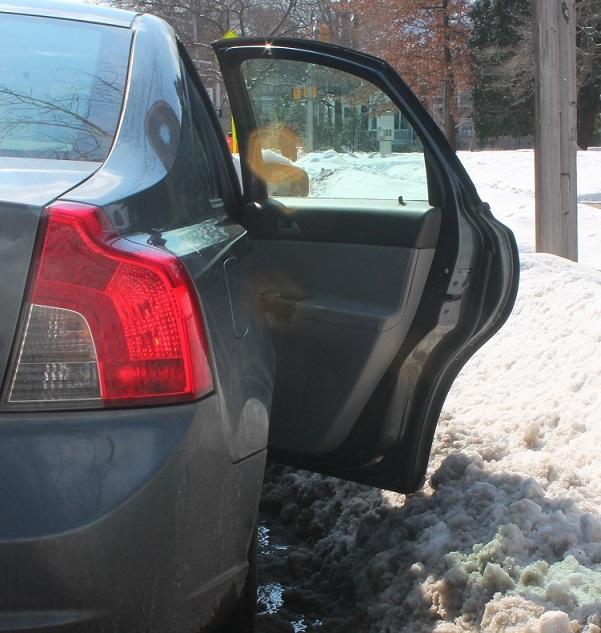 opening-the-car-door-after-it-snows-in-NJ