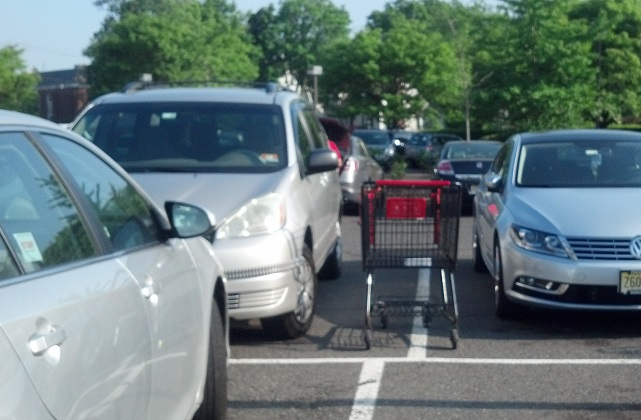 shopping-trolley-abandoned-between-cars
